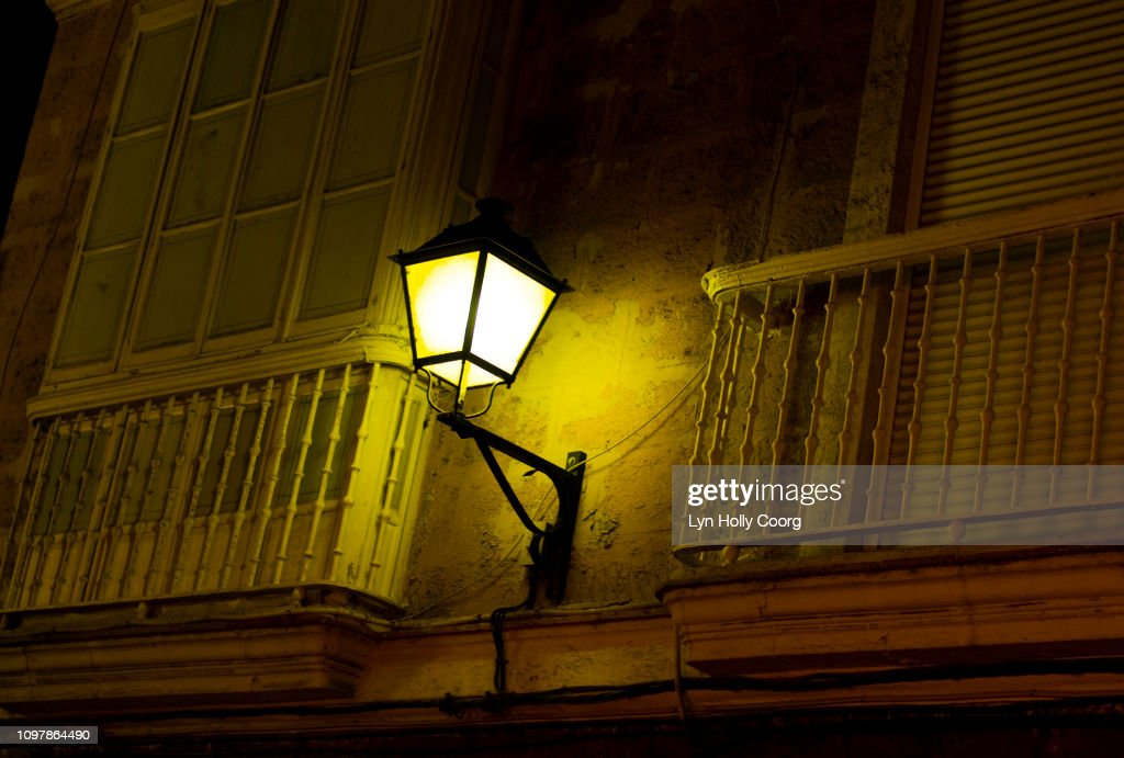 Street lamp and Balconies on old Spanish building : Stock Photo