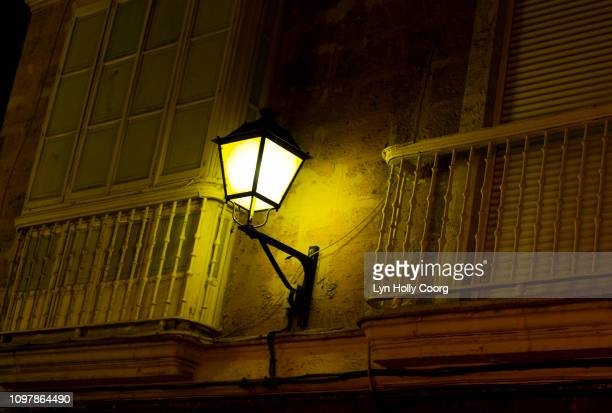 street lamp and balconies on old spanish building - lyn holly coorg stock pictures, royalty-free photos & images