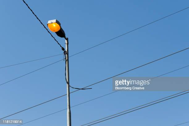street lamp and electricity power lines - soweto towers stock pictures, royalty-free photos & images