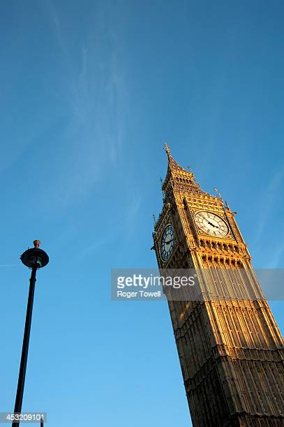 Street lamp and the Clock Tower, which houses Big Ben, part of the Houses of Parliament in central London
