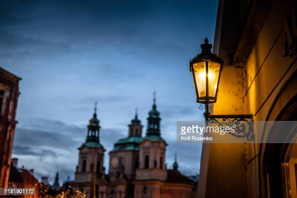 a street lamp in old town of prague - st nicholas' church stock pictures, royalty-free photos & images