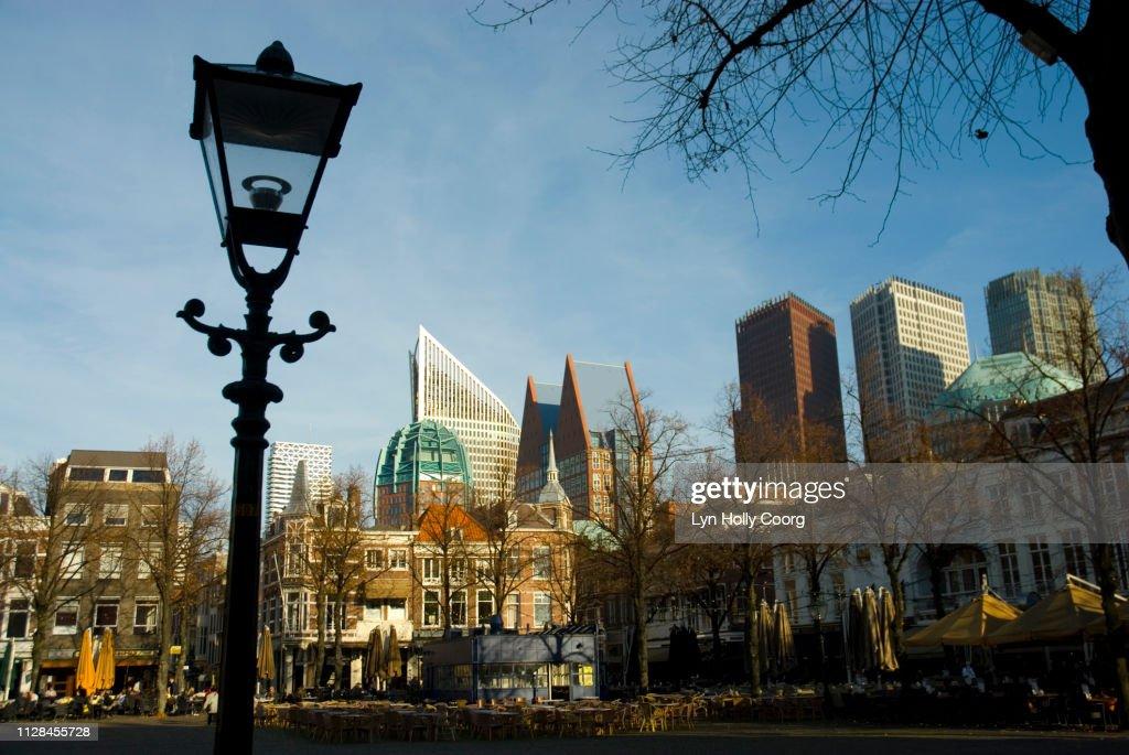Street lamp with Hague city backdrop : Stock Photo