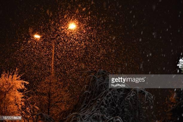 Street lamps illuminate snowflakes during a heavy snowfall in the winter season in Ankara Turkey on December 12 2018