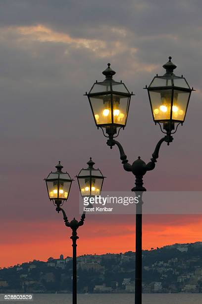 street lamps of naples harbour italy - carving craft product stock pictures, royalty-free photos & images