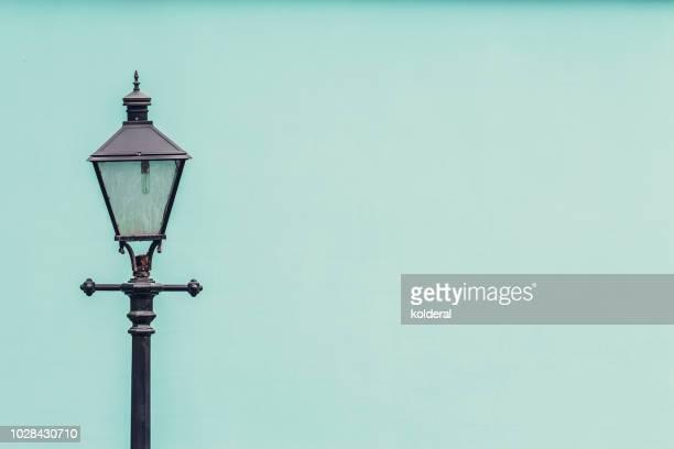 street lantern against teal wall