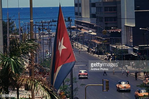 A street leading to the Malecon the waterfront esplanade in Havana Cuba circa 1959