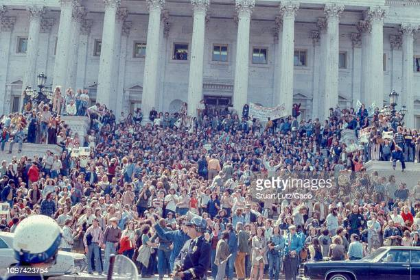 Street level shot of a crowd of protestors on the steps of the US Capitol Building, participating in demonstrations related to the Vietnam War May...