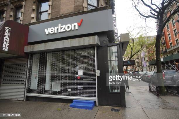 A street lies empty next to a closed Verizon store during the Coronavirus pandemic on April 13 2020 in New York City ShelterInPlace and social...