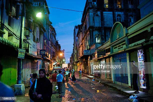 Street life in Burma's former capital Rangoon with wide sidewalks and colonial buildings dominate the scene Since the country opened up to foreign...