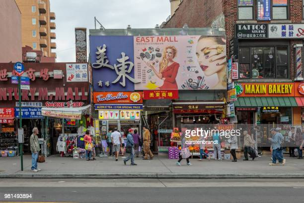 street life in main street in flushing - queens new york city stock pictures, royalty-free photos & images
