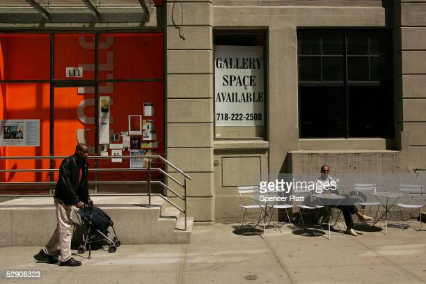 Street life is seen in the DUMBO section of Brooklyn an area that is experiencing rapid gentrification May 17 2005 in New York City New York once on...