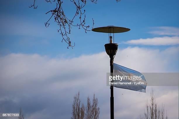 Street Light Against Cloudy Sky