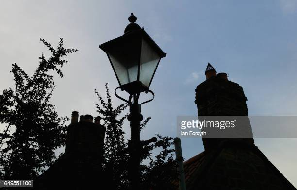 A street light and chimneys in Robin Hood's Bay on the North Yorkshire coast on March 8 2017 in Robin Hood's Bay United Kingdom Robin Hood's Bay is a...