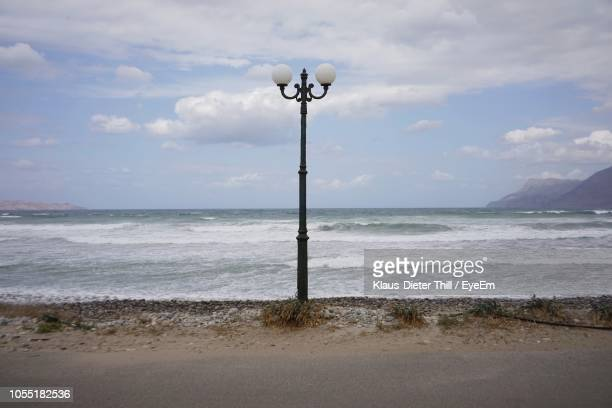 Street Light On Beach Against Sky