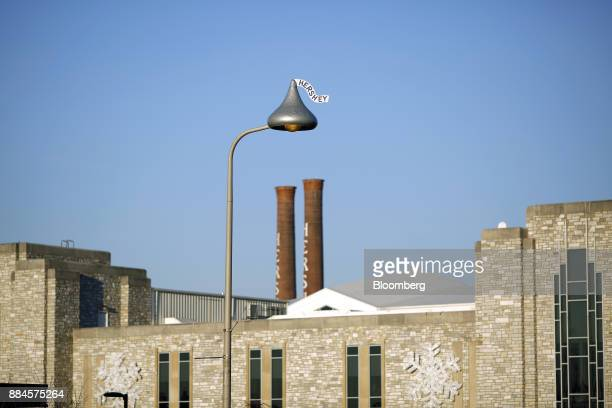 A street light shaped in the likeness of Hershey Co Kisses candy stand in downtown Hershey Pennsylvania US on Tuesday Nov 28 2017 Hershey launched...