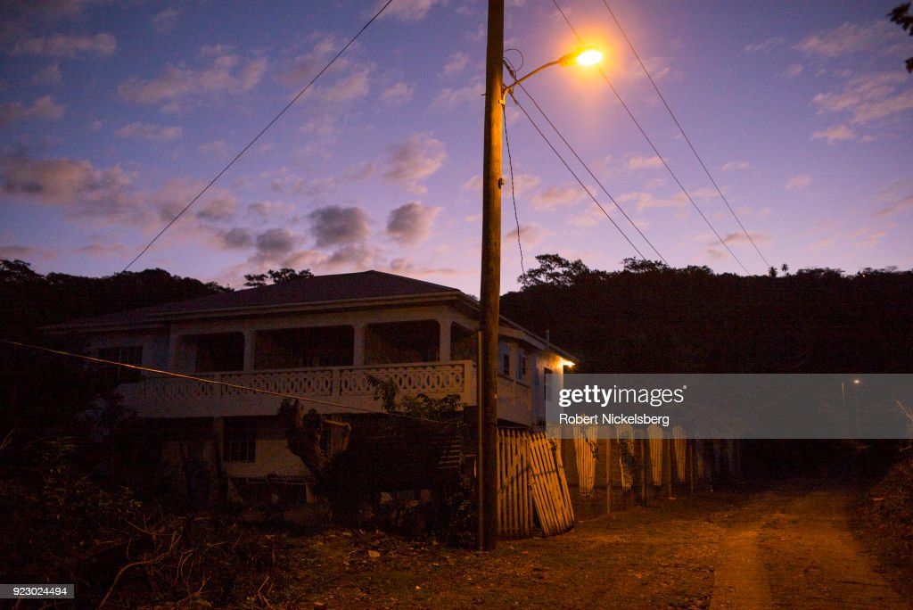 A street light shines on a house and rudimentary road leading to the Cherry Hill district February 3, 2018 on Carriacou, Grenada. Carriacou is one of three islands that make up the country of Grenada.