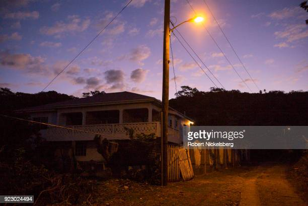 A street light shines on a house and rudimentary road leading to the Cherry Hill district February 3 2018 on Carriacou Grenada Carriacou is one of...
