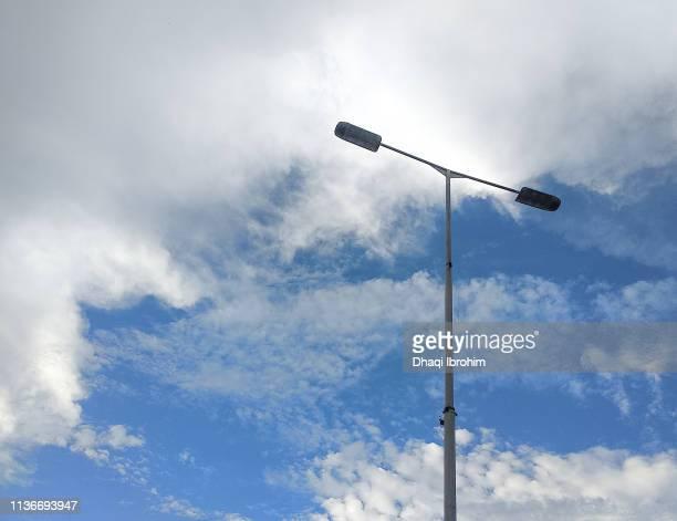 Street Lights And Cloudy Blue Sky