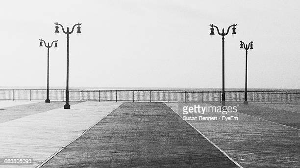 street lights by sea - atlantic city stock pictures, royalty-free photos & images