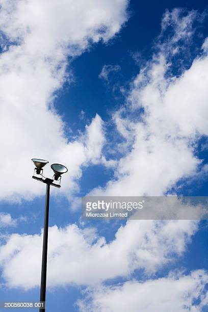 street lights, cloudy sky in background, low angle view - microzoa stock pictures, royalty-free photos & images