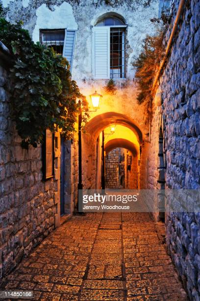 street lights in alley - safed stock photos and pictures