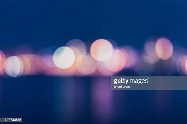 street lights of urban city street at night - soft focus stock pictures, royalty-free photos & images