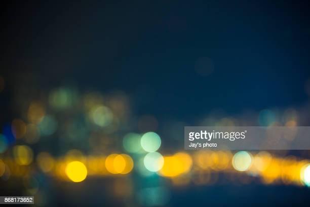 Street lights of urban city street at night
