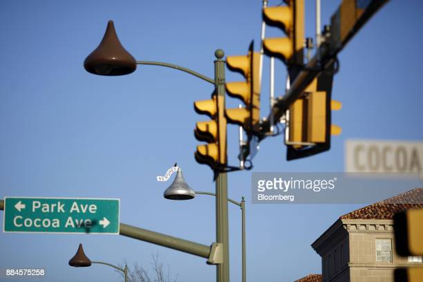 Street lights shaped in the likeness of Hershey Co Kisses candy stand in downtown Hershey Pennsylvania US on Tuesday Nov 28 2017 Hershey launched its...