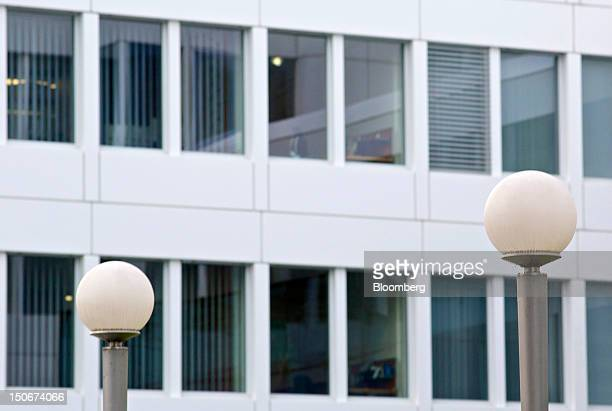 Street lights stand in front of office windows at the headquarters of Glencore International Plc in Baar, Switzerland, on Friday, Aug. 24, 2012....
