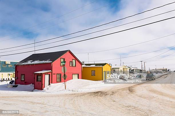A street lined with pink and yellow houses, Barrow, North Slope, Arctic Alaska, USA, Winter