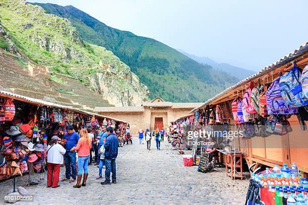 Street market in front of Ollantaytambo ruins, Peru