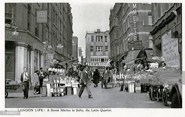 Street market in the Latin Quarter Soho London Shows shoppers browsing the market stalls