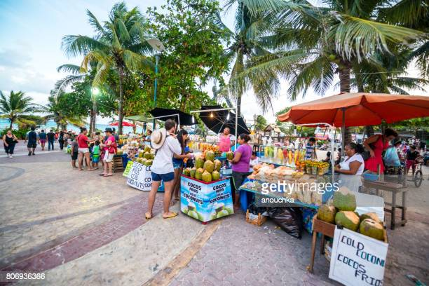 Street Market on Playa Del Carmen selling gifts, fruits and snacks, Mexico