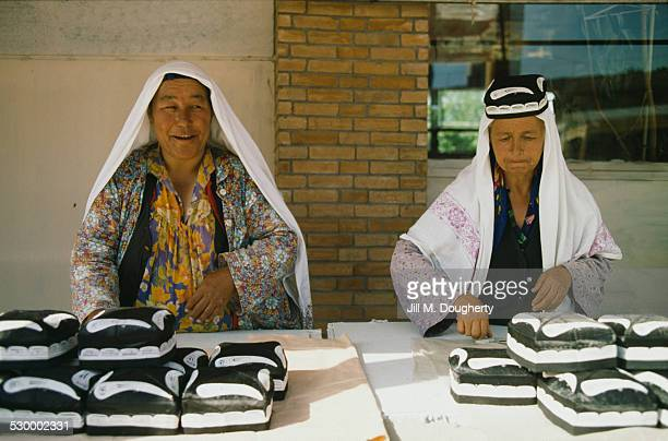 Street market traders at their stall in Uzbekistan circa 1990