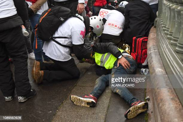 TOPSHOT Street medics give assistance to injured protesters during an antigovernment demonstration called by the Yellow Vests Gilets Jaunes movement...