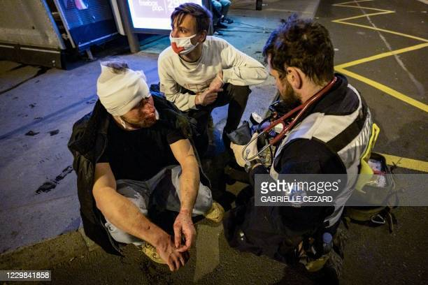 Street medics tend to Syrian freelance photographer Ameer al-Halbi who was injured during clashes in a demonstration against the 'global security'...