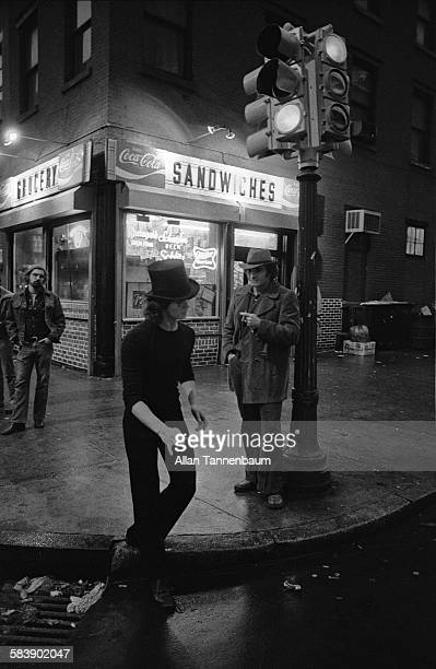 A street mime performs at the corner of West Broadway and Prince Street in SoHo New York New York January 15 1975 A bodega is in the background