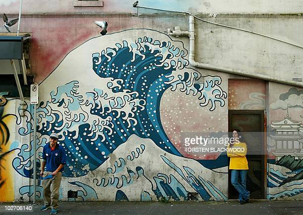 A street mural depicting Japanese artist Katsushika Hokusai's 182933 woodblock classic Under the Wave off Kanagawa features on a wall in a downatheel...