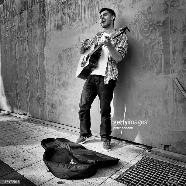 Street musican playing the guitar and singing