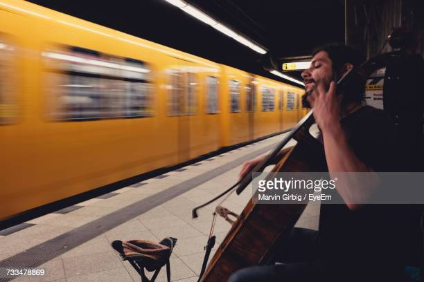 street musician at railroad station - underground stock photos and pictures