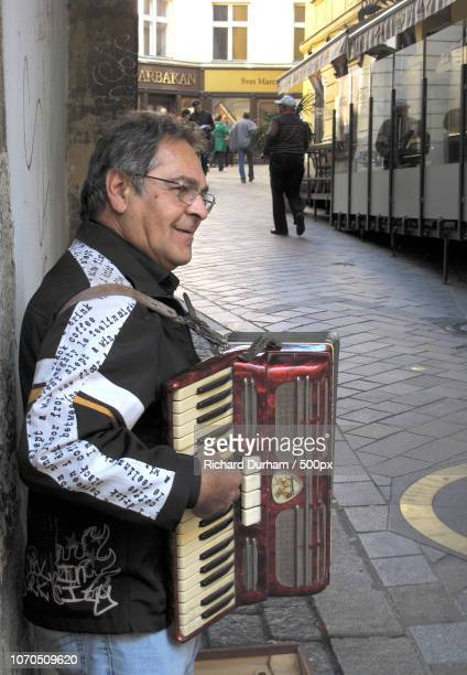 street musician in amsterdam - accordionist stock pictures, royalty-free photos & images