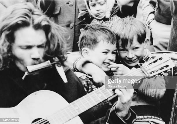 A street musician in Portobello Road London circa 1965
