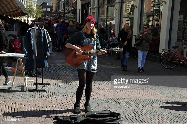 Street musician in the city of Haarlem