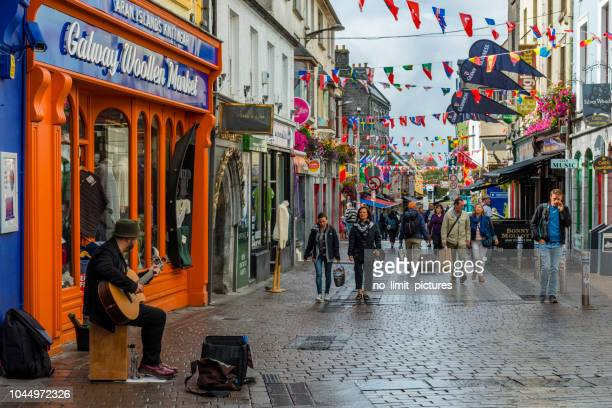 street musician performing in streets of galway - county galway stock pictures, royalty-free photos & images