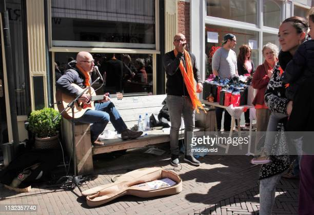 street musician - king's day netherlands stock pictures, royalty-free photos & images