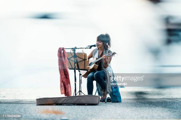 street musician - street artist stock pictures, royalty-free photos & images