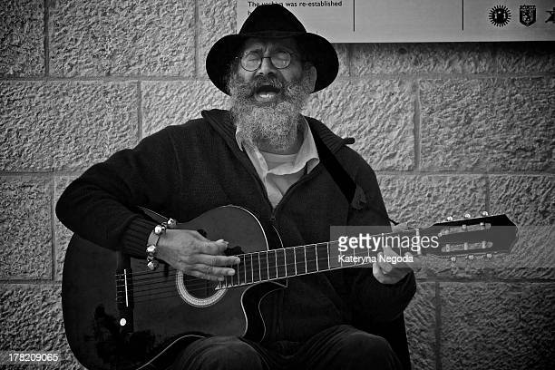 CONTENT] Street musician playing guitar and singing by Wailing Wall The Western Wall Wailing Wall or Kotel is located in the Old City of Jerusalem at...
