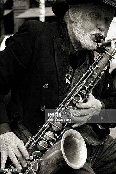 Street musician plays saxophone at Prague Czech Republic Black White