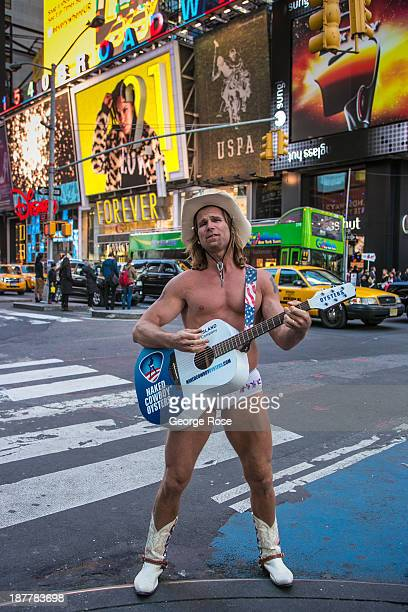 A street musician who goes by the name of 'The Naked Cowboy' performs in Times Square on October 21 2013 in New York City With a full schedule of...