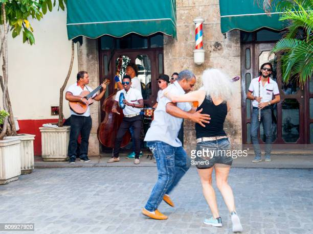 street musicians and dancer in havana - foreigner band stock photos and pictures